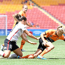 BRISBANE, AUSTRALIA - JANUARY 7: Tameka Butt of the Roar is tackled by Paige Nielsen of the Wanderers during the round 11 Westfield W-League match between the Brisbane Roar and Western Sydney Wanderers at Suncorp Stadium on January 7, 2017 in Brisbane, Australia. (Photo by Patrick Kearney/Brisbane Roar)