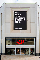 """Sheffield Friday 3 April 2020 <br /> Coronavirus Covid-19 """"Unless your Journey is Essential Stay At Home"""" sign on an electric advertising hoarding above the entrance to H&M Fashion retailer at the top of The Moore Sheffield<br /> <br /> 3 April 2020<br /> <br /> www.pauldaviddrabble.co.uk<br /> All Images Copyright Paul David Drabble - <br /> All rights Reserved - <br /> Moral Rights Asserted -"""