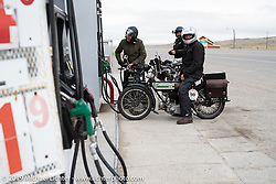 Paul, Arrive and Adrian stop for gas on the Motorcycle Cannonball coast to coast vintage run. Stage 11 (248-miles) from Billings to Great Falls, MT. Tuesday September 18, 2018. Photography ©2018 Michael Lichter.