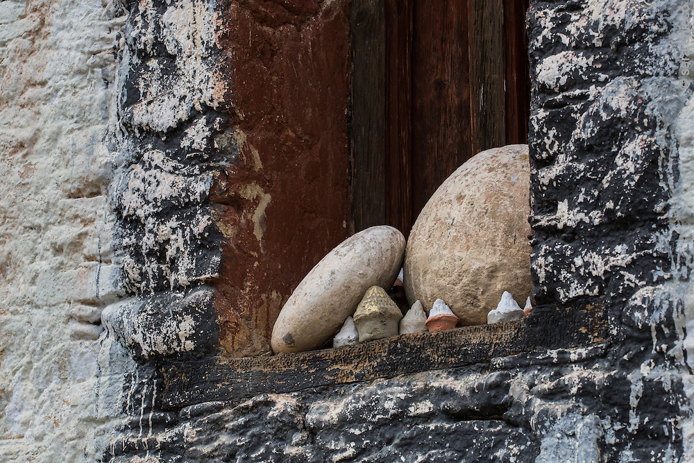 A window sill in Jakar with mini stupas and stones, Bumthang District, Bhutan