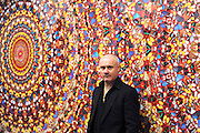 © Licensed to London News Pictures. 02/04/2012. London, UK . Damien Hirst stands in front of 'I Am Become Death, Shatterer of Worlds 2006'. The Tate Modern presents the first substantial retrospective of British artist Damien Hirst. The exhibition tuns 4th April - 9th September at Tate Modern London. Photographers Stephen Simpson/LNP