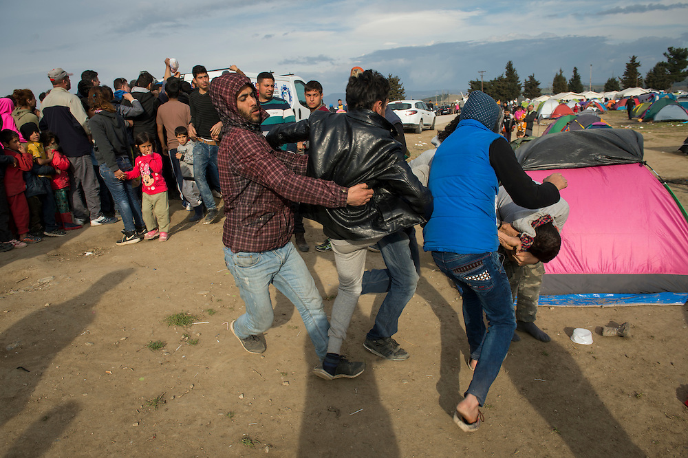 March 4, 2016, Idomeni, Greece. Refugees fight after a dispute during queing for food, which can take up to 4 hours. 12.000 refugees are stuck at the Idomeni border crossing in Greece  after Macedonia closed the border.  New arrivals come in every day, making living conditions tough.(Steven Wassenaar/Polaris)