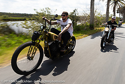 Nick Pensabene riding his custom chopper through Tomoka State Park during Daytona Bike Week. FL. USA. Sunday March 18, 2018. Photography ©2018 Michael Lichter.