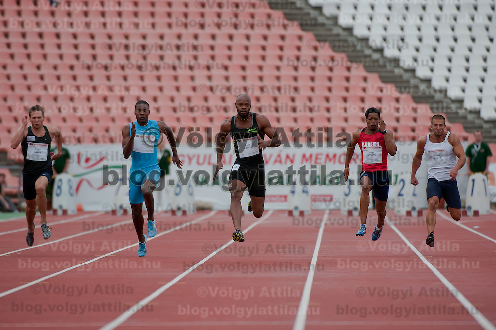 Asafa Powell from Jamaica competes in the men's 100m qualifier he won with 9.86 in the final during the Istvan Gyulai Memorial Hungarian Athletics Grand Prix 2011, in the Ferenc Puskas Stadium in Budapest, Hungary on July 30, 2011. ATTILA VOLGYI