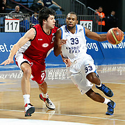 Anadolu Efes's Oliver Lafayette (R) and Erdemir's Altan Erol (L) during their Turkish Basketball League match Anadolu Efes between Erdemir at Arena in Istanbul, Turkey, Wednesday, January 28, 2012. Photo by TURKPIX