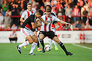 Nottingham Forest defender Eric Lichaj (2)  battles for possession with Brentford midfielder Lewis Macleod (4)  during the EFL Sky Bet Championship match between Brentford and Nottingham Forest at Griffin Park, London, England on 16 August 2016. Photo by Matthew Redman.