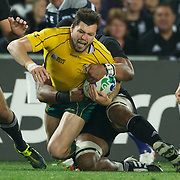 Adam Ashley Cooper, Australia, is tackled during the New Zealand V Australia Semi Final match at the IRB Rugby World Cup tournament, Eden Park, Auckland, New Zealand, 16th October 2011. Photo Tim Clayton...