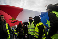 Protesters carring a French flag. More than 125000 gathered in Paris for the Gilets Jaune (Yellow vest) protest. Soon the protest turned violent an protesters clashed with the police, tear gas and flash bombs were fired, many injured and arrested by the police. Paris December 6th 2018. Federico Scoppa