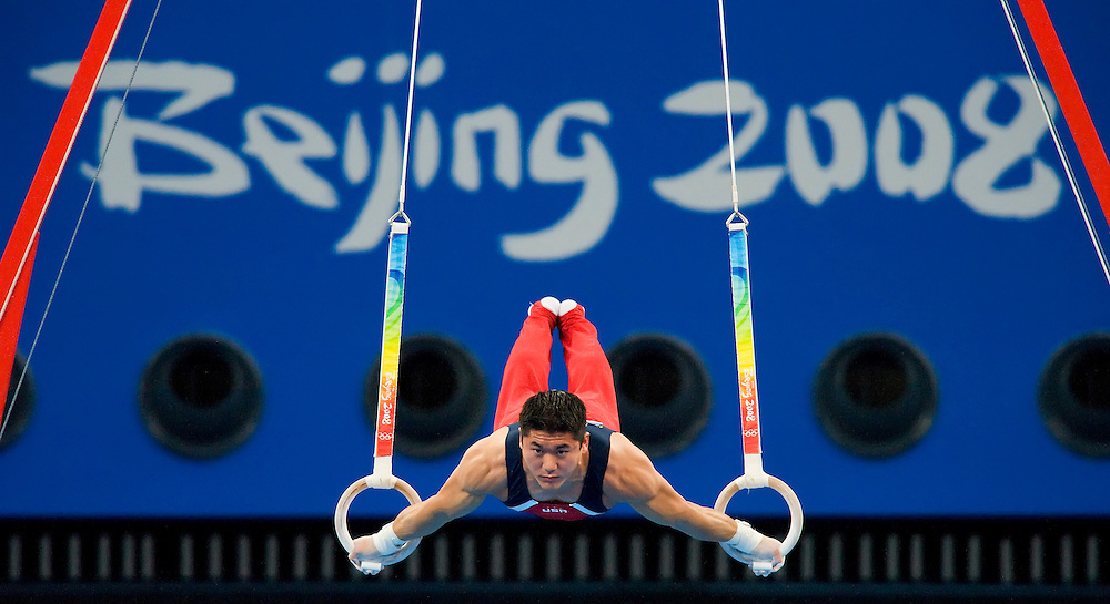 United States gymnast Kai Wen Tan held position in the rings appartus of the men's gymnastics team final August 12, 2008 at the National Indoor Stadium during the 2008 Summer Olympic Games in Beijing, China. China won the overall gold medal, Japan the silver and the United States the bronze. (photo by David Eulitt/MCT)