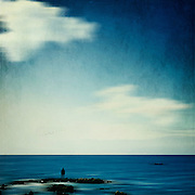 Abstraction of a person standing on rocks staring at the sea.<br /> <br /> Licenses: http://www.trevillion.com/search/preview/trevillion/0_00219346.html