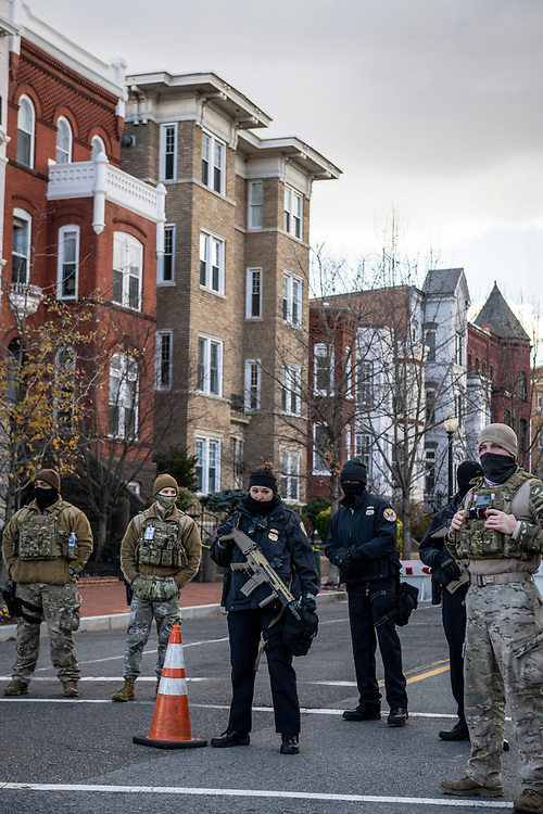 Washington DC, USA - January 18, 2021: Supreme Court police, members of the Air Force's Air Combat Command, and other security personnel control access to 2nd Street at the intersection of Maryland Avenue on Capitol Hill.