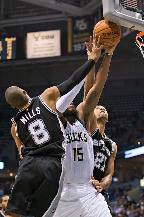 """MILWAUKEE, WI- JANUARY 4:  Patty Mills #8 of the San Antonio Spurs blocks the shot by Greg Monroe #15 of the Milwaukee Bucks at BMO Harris Bradley Center on January 4, 2016 in Milwaukee, Wisconsin.  """"NOTE TO USER: User expressly acknowledges and agrees that, by downloading and or using this photograph, User is consenting to the terms and conditions of the Getty Images License Agreement.""""(Photo by Wesley Hitt/Getty Images) *** Local Caption *** Patty Mills; Greg Monroe"""