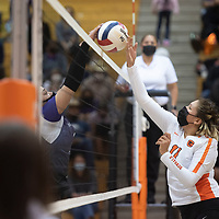 Gallup's Jordan Joe (11) and Miyamura's Darian Yazzie (11) try to win the point at the net during their match at Gallup High School Thursday night in Gallup. The Gallup Bengals defeated the Patriots 22-25, 25-23, 25-22, 25-14 to become district champions.