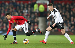 5 January 2018 - FA Cup (3rd Round) Football - Manchester United v Derby County - Jesse Lingered of Man Utd is chased down by Tom Lawrence of Derby - Photo: Charlotte Wilson / Offside