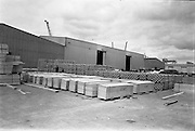 """09/06/1967<br /> 06/09/1967<br /> 09 June 1967<br /> Asbestos sheets and pipes being exported to Ghana from Ocean Pier, Dublin. 200 tons of asbestos cement light weight shearing specially designed for export and asbestos cement pipes were shipped on the Nigerian vessel """"King Jaja"""". Shipment was part of an order fulfilled by Asbestos Cement Ltd. Athy, Co. Kildare. Picture shows part of the order on the Quay."""