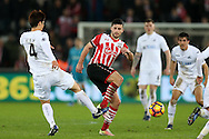 Shane Long of Southampton © is challenged by Ki Sung-Yueng of Swansea city. Premier league match, Swansea city v Southampton at the Liberty Stadium in Swansea, South Wales on Tuesday 31st January 2017.<br /> pic by  Andrew Orchard, Andrew Orchard sports photography.