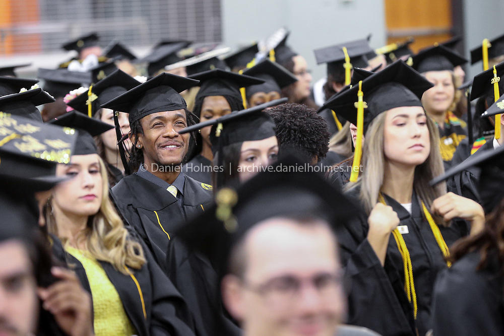 (5/26/19, WORCESTER, MA) Students wait for the ceremony to start during the Framingham State University's undergraduate commencement ceremony at the DCU Center in Worcester on Sunday. [Daily News and Wicked Local Photo/Dan Holmes]