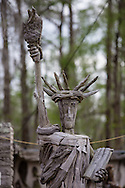 Pierre Part, Louisiana, March 18th, 2013, The Statue of Liberty made out of  Cypress drift wood by self-taught artist Adam Morales in front of his home and museum.  The Adam's Driftwood Museum is at the end of South Bay Road on the bayou is an off the beaten trail toursit destination.
