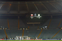 A ball flies into the area from a corner amid an empty Stadio Olympico. Fans were banned after the referee was hit by a missle during a previous Champion's League match.