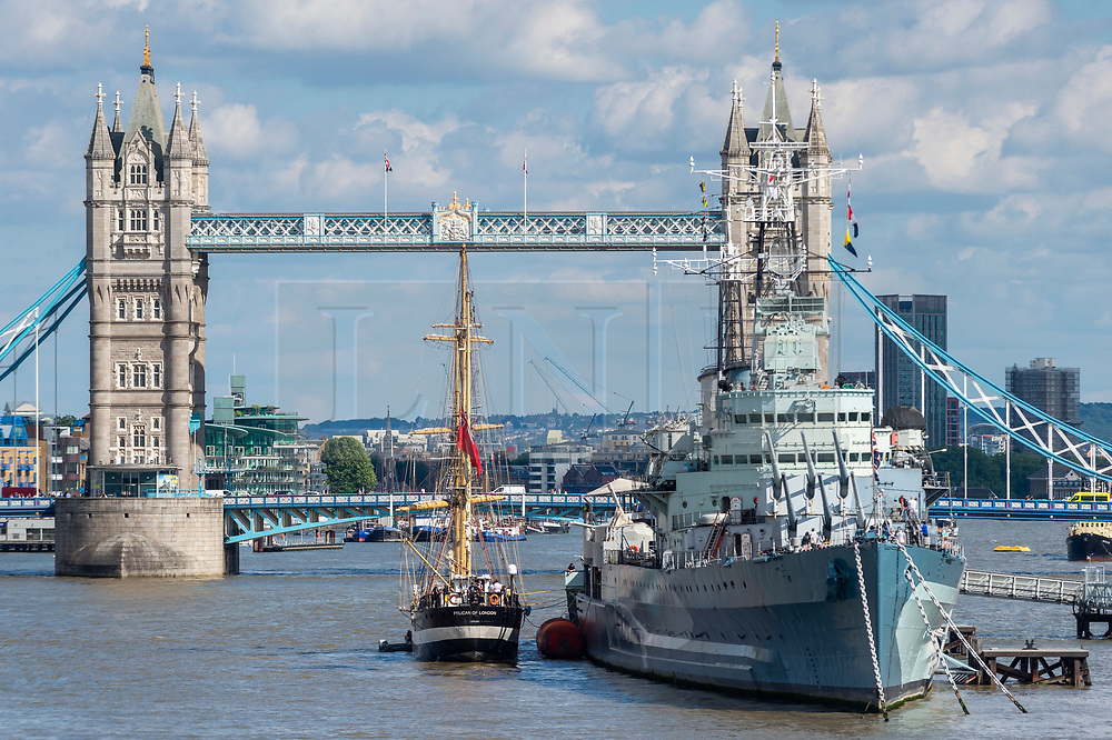 """© Licensed to London News Pictures. 10/08/2021. LONDON, UK.  The tall ship """"Pelican of London"""" after passing through Tower Bridge.  Unique among Square Riggers, her hull form was derived from the elite French clippers of the late 19th century, with a length to breadth ratio of 5:1.  She is moored next to HMS Belfast until 14 August.  TS Pelican is designed principally as a sail training ship but also competes in events worldwide.  Photo credit: Stephen Chung/LNP"""