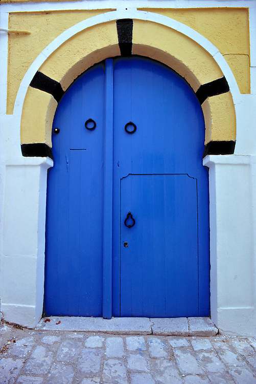 A beautiful blue door beckons in Sidi Bou Said, Tunisia.