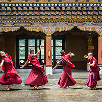 Bhutanese monks dancing at the Rinpung Dzong in Paro.<br /> <br /> --<br /> <br /> This photo is free for the non-commercial personal use of subscribers to the Xpat Matt newsletter. <br /> <br /> This photo is not for licensed editorial or commercial use. For editorial or commercial licensing, contact matt@xpat.media.