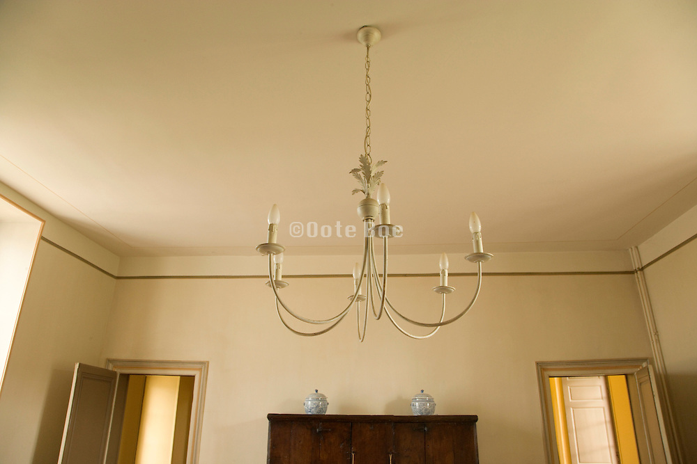 chandelier hanging from ceiling daytime