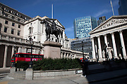 City of London financial district looking towards the Royal Exchange at Bank is virtually deserted due to the Coronavirus outbreak on 23rd March 2020 in London, England, United Kingdom. Following government advice city workers are staying at home to work leaving the streets quiet, empty and eerie. Coronavirus or Covid-19 is a new respiratory illness that has not previously been seen in humans. While much or Europe has been placed into lockdown, the UK government has announced more stringent rules as part of their long term strategy, and in particular social distancing.