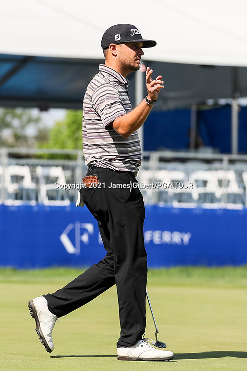 WICHITA, KS - JUNE 20: Kevin Lucas acknowledges the crowd after sinking his putt on the 17th green during the final round of the Wichita Open Benefitting KU Wichita Pediatrics at Crestview Country Club on June 20, 2021 in Wichita, Kansas. (Photo by James Gilbert/PGA TOUR via Getty Images)