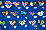 Commemoration of the first anniversary of the devastating fire of 14th/15th June 2017 in Grenfell Tower, Lancaster West Estate, West London, United Kingdom when 72 people were killed. A local school displays childrens art made in response to a request to draw someone important to you.