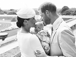 NEWS EDITORIAL USE ONLY. NO COMMERICAL USE. NO MERCHANDISING, ADVERTISING, SOUVENIRS, MEMORABILIA or COLOURABLY SIMILAR. NOT FOR USE AFTER AFTER 31 DECEMBER, 2019 WITHOUT PRIOR PERMISSION FROM ROYAL COMMUNICATIONS. NO CROPPING. Copyright in this photograph is vested in The Duke and Duchess of Sussex. Publications are asked to credit the photographs to Chris Allerton. No charge should be made for the supply, release or publication of the photograph. The photograph must not be digitally enhanced, manipulated or modified in any manner or form and must include all of the individuals in the photograph when published. This official christening photograph released by the Duke and Duchess of Sussex shows the Duke and Duchess with their son, Archie Harrison Mountbatten-Windsor at Windsor Castle with with the Rose Garden in the background.
