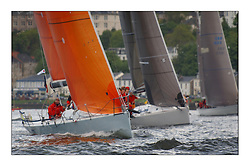 Yachting- The first days racing  of the Bell Lawrie Scottish series 2003 at Gourock.  The wet start looks set to last for the overnight race to Tarbert...Last years winner Hamish McKay and crew in their chartered Kerr 11.3 GBR1109L Blue Bell of Kip below Kylidh and Desperado at Gourock...Pics Marc Turner / PFM
