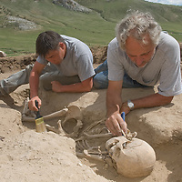Smithsonian archaeologist & forensics specialist, Dr. Bruno Frohlich, & Amgalantugs Tsend, a Mongolian archaeology student, unearth a bronze-age skeleton at a site above the Delger River near Muren, Mongolia. The  skeleton may be 2700+ years old.g