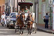 09 JANUARY 2007 - GRANADA, NICARAGUA: A horse cart used as a taxi in Granada, Nicaragua. Granada, founded in 1524, is one of the oldest cities in the Americas. Granada was relatively untouched by either the Nicaraguan revolution or the Contra War, so its colonial architecture survived relatively unscathed. It has emerged as the heart of Nicaragua's tourism revival. Nicaragua is one of the poorest countries in the Americas and many people still horse carts for transportation. PHOTO BY JACK KURTZ