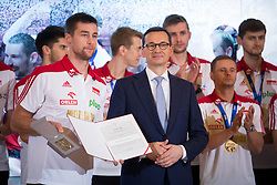 October 1, 2018 - Warsaw, Poland - Michal Kubiak and Prime Minister of Poland Mateusz Morawiecki during the meeting with Poland men's national volleyball team at Chancellery of the Prime Minister in Warsaw, Poland on 1 October 2018. Poland won the gold medal after defeating Brazil in FIVB Volleyball Men's World Championship Final in Turin on 30 September. (Credit Image: © Mateusz Wlodarczyk/NurPhoto/ZUMA Press)