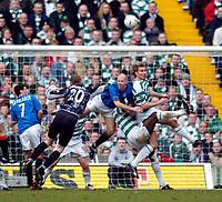 Photo. Jed Wee, Digitalsport<br /> Glasgow Celtic v Glasgow Rangers, Scottish FA Cup, Celtic Park, Glasgow. 07/03/2004.<br /> Rangers's Henning Berg (L) loses out to Celtic's Stanislav Varga at a Rangers corner.