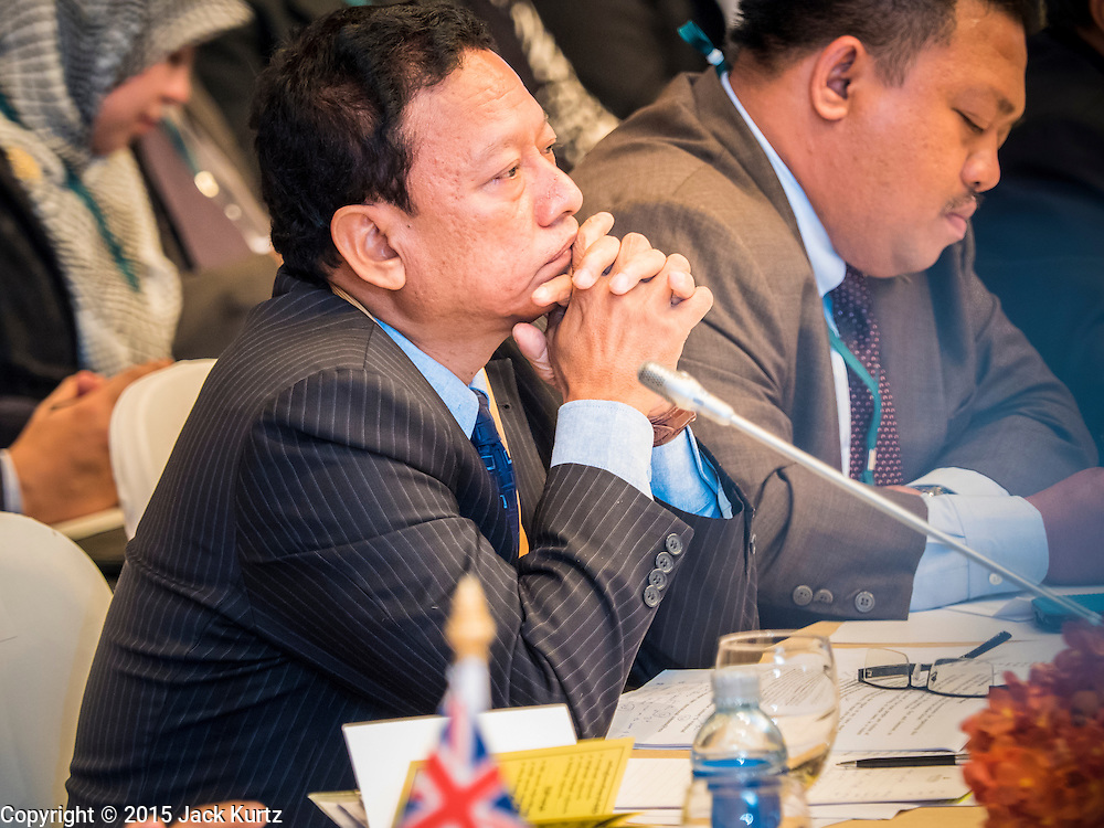 """29 MAY 2015 - BANGKOK, THAILAND:  HTIN LYNN, Special Representative of the Myanmar Ministry of Foreign Affairs, listens to the UNHCR representative talk about Myanmar's treatment of ethnic minorities in Myanmar, including the Rohingya, during the """"Special Meeting on Irregular Migration in the Indian Ocean."""" Thailand organized and hosted the meeting at the Anantara Siam Hotel in Bangkok. The meeting brought together representatives from the 5 countries impacted by the boat people exodus: Thailand, Malaysia and Indonesia, which have all received boat people, and Myanmar (Burma) and Bangladesh, where they are coming from. Non-governmental organizations, like the International Organization for Migration (IOM) and UN High Commissioner for Refugees (UNHCR) as well as countries responding to the crisis, like the United States, also attended the meeting. A total of 22 organizations attended the one day conference.     PHOTO BY JACK KURTZ"""