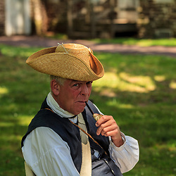 Washington Crossing, PA, USA - June 23, 2012: A costumed colonist reenactor at the Washington Crossing Historic Park  in Bucks County, PA.
