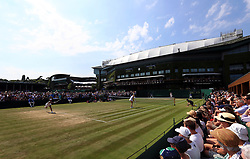 General view of the Doubles match between Harriet Dart and Katy Dunne against Heather Watson and Naomi Broady (near court) on day four of the Wimbledon Championships at The All England Lawn Tennis and Croquet Club, Wimbledon.