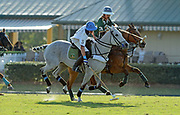 March 12, 2021, The Villages, Florida, USA;  Nick Johnson of Arden's Fine Jewelers chasing down the polo ball against Martin Ravina of The Villages Insurance.