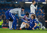 Football - 2018 / 2019 EFL Carabao Cup (League Cup) - Semi-Final, Second Leg: Chelsea (0) vs. Tottenham Hotspur (1)<br /> <br /> David Luiz (Chelsea FC) winces as he rises to his feet after being fouled at Stamford Bridge <br /> <br /> COLORSPORT/DANIEL BEARHAM