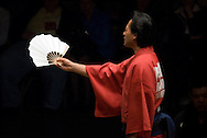 A yobidashi (usher) announces the wrestler's names prior to a match at the 2005 Grand Sumo Championship Las Vegas tournament, Mandalay  Bay Resort & Casino, Las Vegas, Nevada