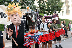 """July 26, 2018 - New York City, New York, US - A coalition of immigration advocates rallied on the steps of the Department of Homeland Security (DHS) in lower Manhattan on 26th. July, 2018, in support of migrants for a """"Deportee Suitcase Action"""" rally. Organizers – The New Sanctuary Coalition – issued a statement asking, """"… to think about one person — someone you love — and imagine packing a suitcase for that person before they are deported to a country where you might never see them again. (Credit Image: © G. Ronald Lopez via ZUMA Wire)"""
