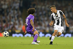 3rd June 2017 - UEFA Champions League Final - Juventus v Real Madrid - Paulo Dybala of Juventus flicks the ball past Marcelo of Real - Photo: Simon Stacpoole / Offside.