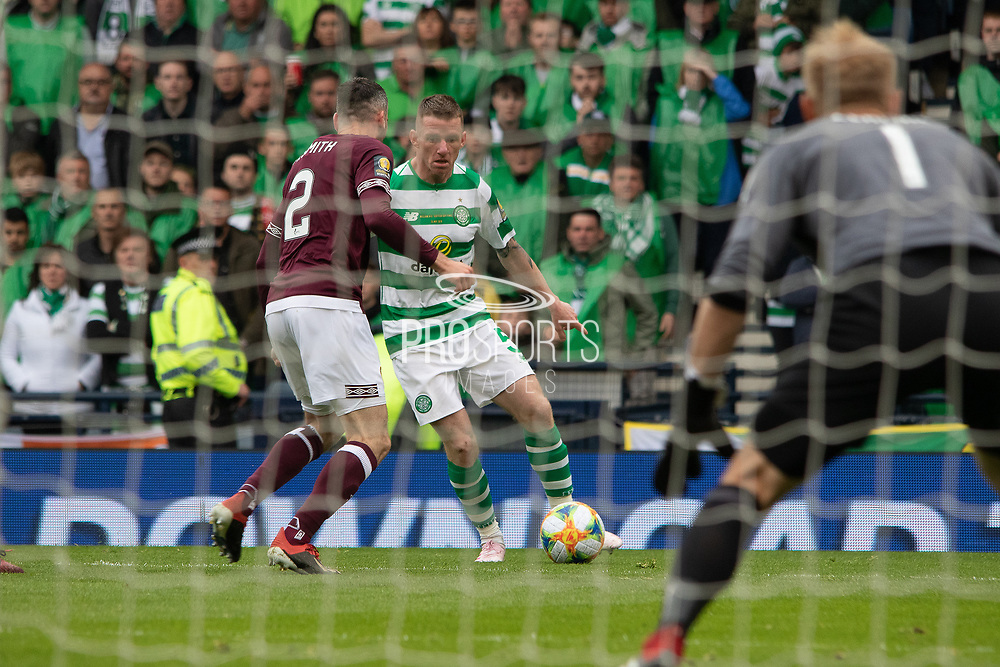 Celtic's Jonny Hayes looking to get around Michael Smith of Hearts during the William Hill Scottish Cup Final match between Heart of Midlothian and Celtic at Hampden Park, Glasgow, United Kingdom on 25 May 2019.
