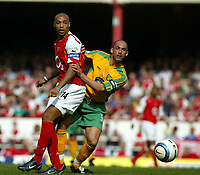 Photo. Chris Ratcliffe, Digitalsport<br /> Arsenal v Norwich City. Barclays Premiership. 02/04/2005<br /> Thierry Henry flicks the ball away from Craig Fleming of Norwich