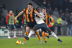 Manchester United's Paul Pogba (right) and Hull City's Harry Miguire battle for the ball during the EFL Cup Semi Final, Second Leg match at the KCOM Stadium, Hull.