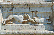 Sculptures on the 12th century Romanesque facade of the Chiesa di San Pietro extra moenia (St Peters), Spoletto, Italy .<br /> <br /> Visit our MEDIEVAL PHOTO COLLECTIONS for more   photos  to download or buy as prints https://funkystock.photoshelter.com/gallery-collection/Medieval-Middle-Ages-Historic-Places-Arcaeological-Sites-Pictures-Images-of/C0000B5ZA54_WD0s