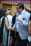 MEHREEN KHURSHEED; FOUAD KANAAN, Drinks party to launch this year's Frieze Masters.Hosted by Charles Saumarez Smith and Victoria Siddall<br />  Academicians' room - The Keepers House. Royal Academy. Piccadilly. London. 3 July 2014