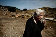 A woman cries as she visits an area completely devastated by the tsunami in Pelluhue, Chile, March 2, 2010.